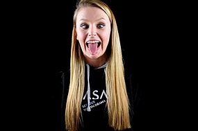 Blonde young woman pulling a silly face